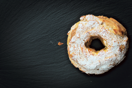Paris Brest Famous French dessert sweet  round pastry in the form of a wheel on black slate plate with copy space Stock Photo