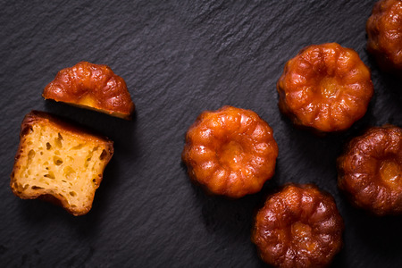 French pastry Canele rum and vanilla flavor thick caramelized crust on black slate plate 版權商用圖片