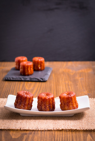 French pastry Canele rum and vanilla flavor thick caramelized crust with copy space