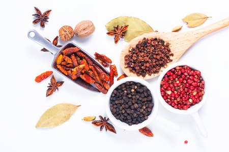 Exotic herbal Food concept Mix of the organic Spices cardamom pods, bay leaves, star anise, peppercorn, chilli, nutmeg,Sichuan peppercorns and coriander seeds