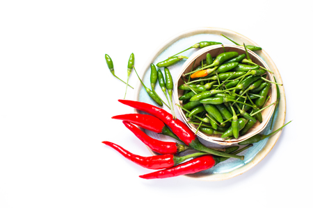 Food concept Chili Padi, Birds Eye Chili, Thai pepper and red chili on bamboo tray with copy space