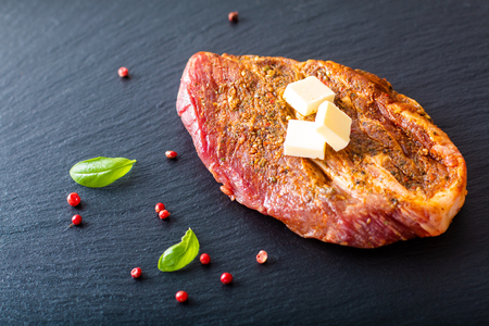 Food concept Marinated Sirloin meat steak on black slate stone plate with copy space 스톡 콘텐츠