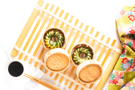 Asian Food concept homemade Dim Sum steamed garlic chives dumplings in Dim Sum Bamboo Steamer Basket on white background