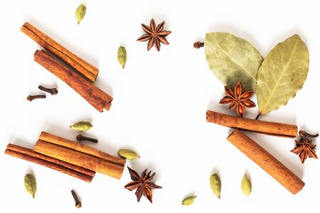Healthy food concept Mix of organic spices star anise, cinnamon, bay and cardamom pods on white background Фото со стока