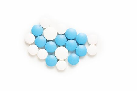 Health and medication concept blue and white pills drug or tablets on white background with copy space