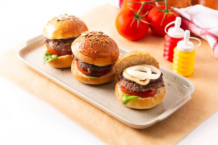 Food concept Homemade beefs hamburgers serve on square plate on white background with copy space