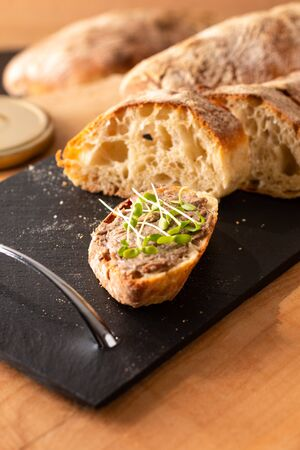 Food Concept french beefs Rillettes  spread on homemade crusty artisan ciabatta bread with flax microgreen for breakfast or breaking snack Stock fotó