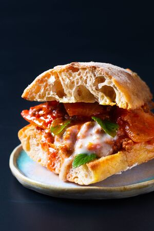 Homemade food concept Organic bolognese grill artisan bread sandwich on black background with copy space Фото со стока