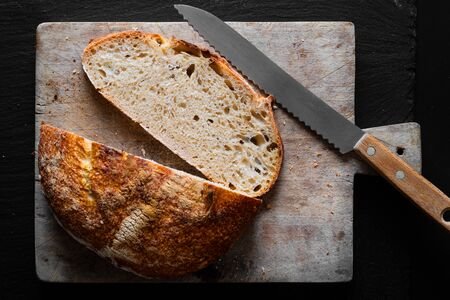 Home Cooking Homemade Organic Sourdough bread on black background with copy space Standard-Bild