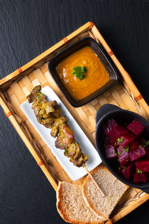 Asian food concept  homemade beef satay grilled and spicy peanut spice sauce  on bamboo tray with copy space Stok Fotoğraf