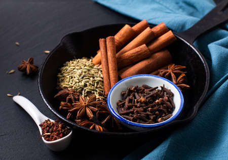 Food concept origin Chinese Five Spice  Star Anise, Fennel Seeds, Szechuan Peppercorns, Whole Cloves and Cinnamon Stick on black rustic background with copy space Stok Fotoğraf