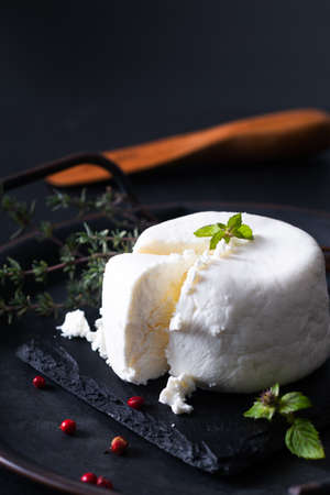 Local food concept organic fresh Goat cheese on black slate stone board background with copy space Stok Fotoğraf