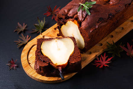 Food  dessert concept Homemade Rustic chocolate cake or brownie and Pear Cake on black slate stone board with copy space 免版税图像