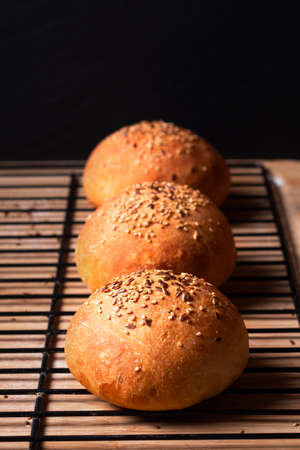 Food concept  fresh baked Homemade Hamburger buns on black background with copy space