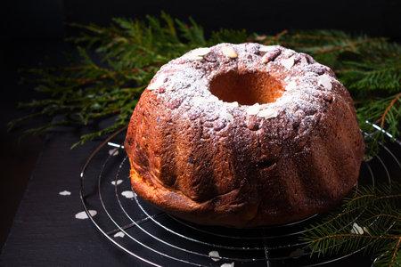 Food Concept homemade Gugelhupf, Guglhupf, Kugelhopf, kouglof bundt yeast cake of Central Europe on black background
