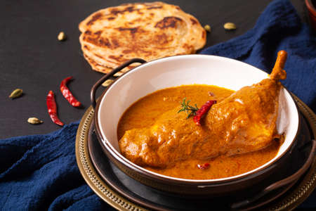Food concept Homemade Tikka Masala Chicken or red curry on black background with copy space