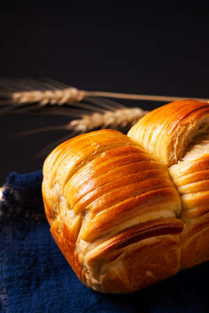 Food concept spot focus Homemade organic Wool soft milk bread on black background with copy space