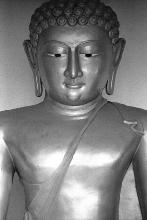 dhamma: Grainy B W film photo of Buddha statue Stock Photo