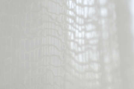 highkey: An abstract pattern of a white net in a high-key photo