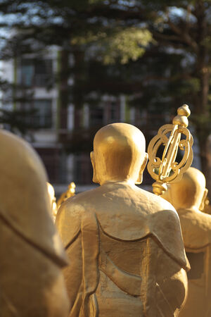 Back of Chinese monk arahant statues standing in a Thai temple  photo