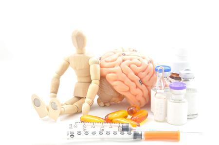 diagnosis of human brain and wooden human model photo