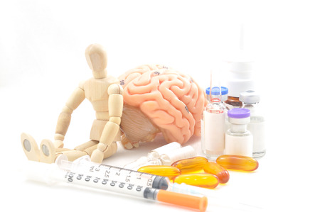 oblongata: diagnosis of human brain and wooden human model Stock Photo