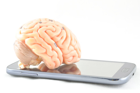 oblongata: brain and mobile phone Stock Photo