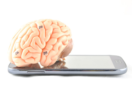 brain and mobile phone Stock Photo