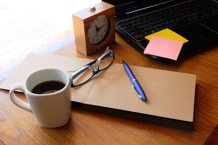 teaching stations: note book and laptop on wooden table with coffee Stock Photo