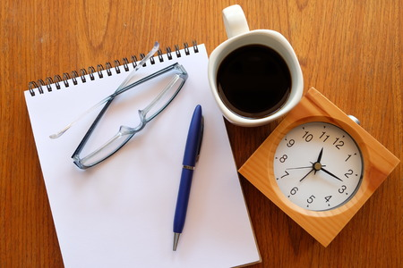 teaching stations: note book on wooden table with coffee