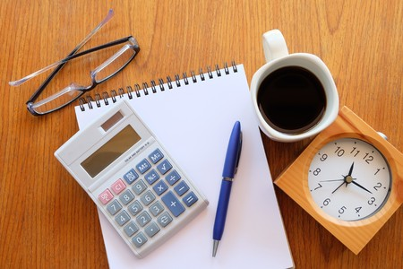 teaching stations: calculator on the wooden table with back coffee