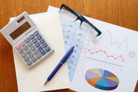 teaching stations: calculator and chart on the wooden table Stock Photo