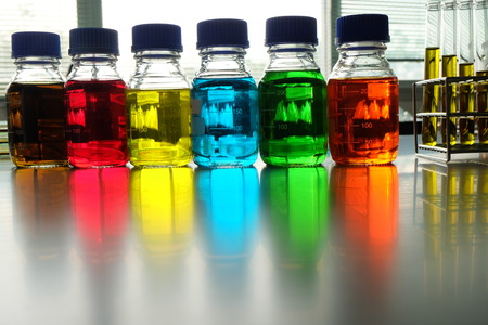microbial: Colorful fluid in bottle and test tube for laboratory use on table laboratory