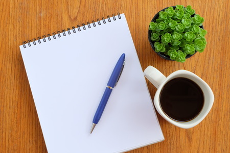 teaching stations: note book on the wooden table Stock Photo