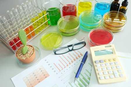 microbial: work table in laboratory and colorful fluid in glassware