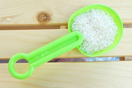 plastic spoon: rice in plastic spoon