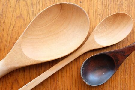 wooden plate: wooden spoon on wooden background