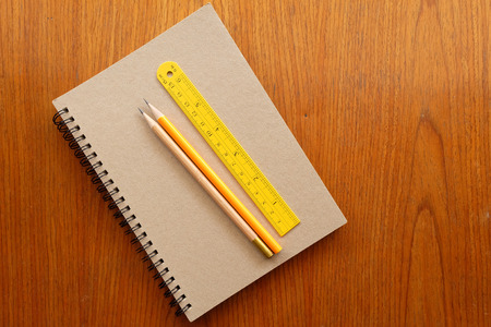 office tool: note book and office tool on wooden background