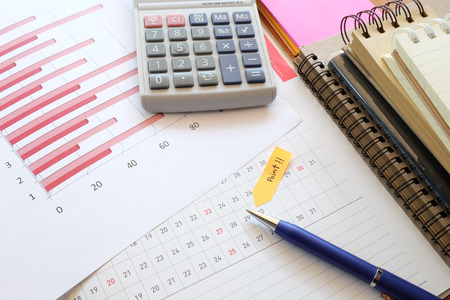 point wording on note paper with planner and chart