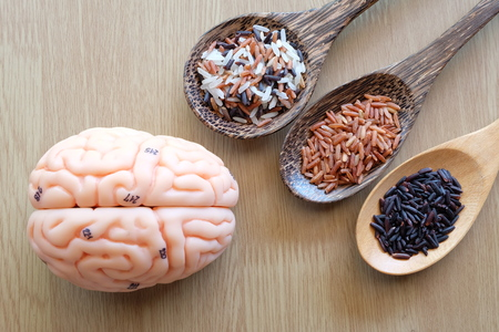 wooden spoon: variety rice in the wooden spoon and brain on wooden background with healthy concept Stock Photo