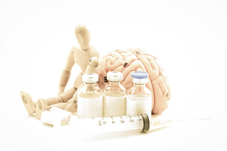 wooden doll: Flexible wooden doll and human brain Stock Photo