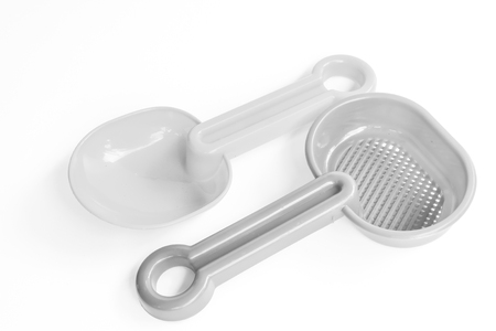 plastic spoon with black and white color