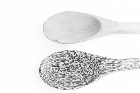 wooden spoon with black and white color
