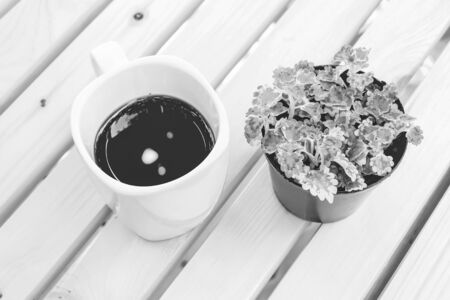 black coffee on wooden table with black and white color Banco de Imagens