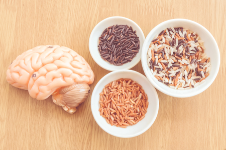 thalamus: brain and three types of rice on wooden background with vintage color Stock Photo