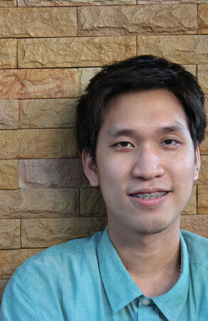 Asian Man is Smiling with Dental Braces photo
