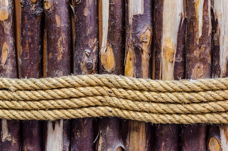 The strong ropes tie around the  wood lump  photo