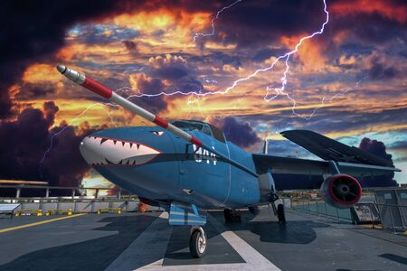 Historic jet on flight deck of aircraft carrier with storm raging in background as lighting strikes composite image moody powerful striking concept freedom and strength.
