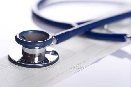 stethoscope and ekg isolated on white background, close up Standard-Bild