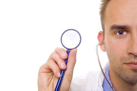 caucasian doctor holding stethoscope in hand, close up Standard-Bild